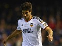 Andre Gomes of Valencia runs with the ball during the La Liga match between Valencia CF and Real Madrid CF at Estadi de Mestalla on January 4, 2015