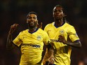 Jermaine Pennant of Wigan Athletic (L) celebrates with Gaetan Bong as he scores their first and equalising goal from a free kick during the Sky Bet Championship match between Fulham and Wigan Athletic at Craven Cottage on April 10, 2015