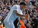 Manchester City's Argentinian striker Carlos Tevez celebrates scoring his third goal with a golf swing celebration during the English Premier League football match between Norwich City and Manchester City at Carrow Road stadium in Norwich, England on Apri