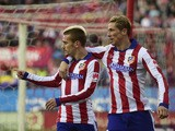 Atletico Madrid's French forward Antoine Griezmann celebrates a goal with teammate Atletico Madrid's forward Fernando Torres during the Spanish league football match Club Atletico de Madrid vs Real Sociedad de Futbol at the Vicente Calderon stadium in Mad