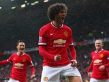 Marouane Fellaini of Manchester United celebrates as he scores their second goal with a header during the Barclays Premier League match between Manchester United and Manchester City at Old Trafford on April 12, 2015