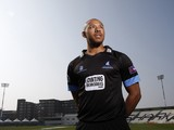 Tymal Mills poses for a portrait during the Sussex County Cricket Photocall at BrightonandHoveJobs.com County Ground on April 9, 2015