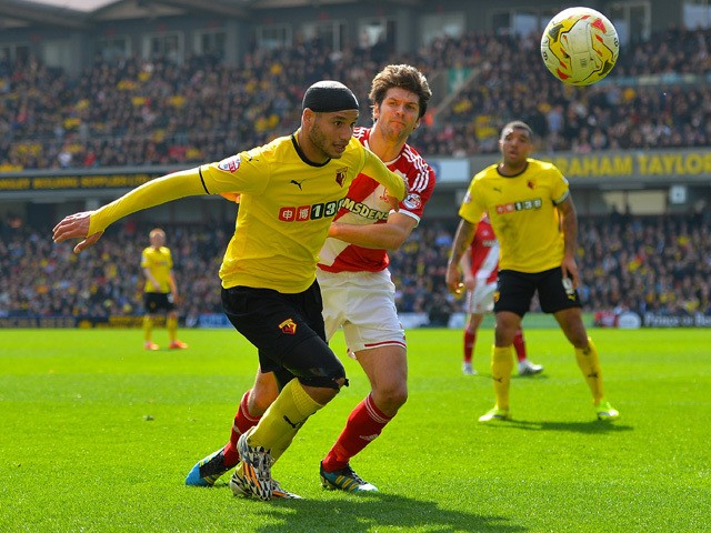 Adlene Guedioura of Watford FC holds off George Friend of Middlesbrough FC during the Sky Bet Championship match between Watford and Middlesbrough at Vicarage Road on April 6, 2015