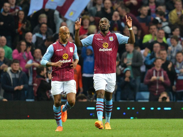 Aston Villa's Zaire-born Belgian striker Christian Benteke celebrates scoring their first goal during the English Premier League football match between Aston Villa and Queens Park Rangers at Villa Park in Birmingham, central England on April 7, 2015