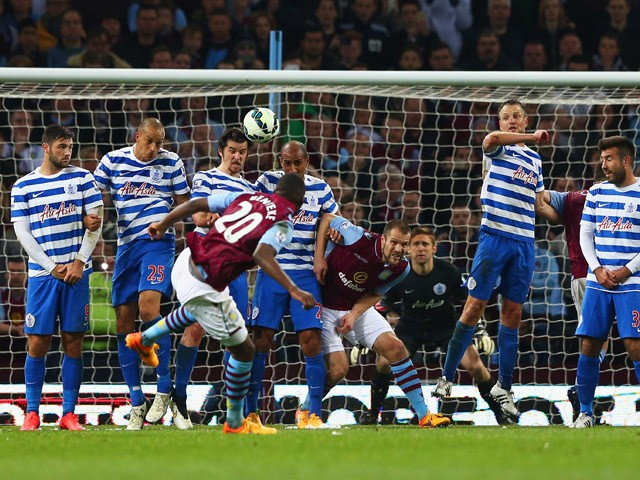 Christian Benteke of Aston Villa (20) scores their third goal from a free kick and completes his hat trick during the Barclays Premier League match between Aston Villa and Queens Park Rangers at Villa Park on April 7, 2015