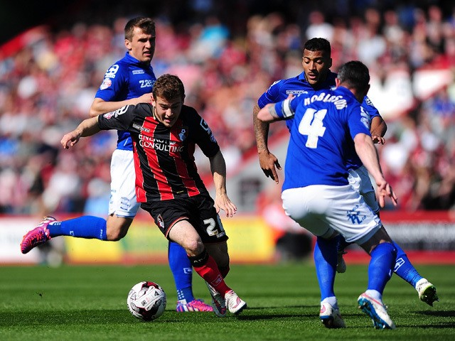 Ryan Fraser of AFC Bournemouth takes on Paul Robinson of Birmingham City during the Sky Bet Championship match between AFC Bournemouth and Birmingham City at Goldsands Stadium on April 6, 2015