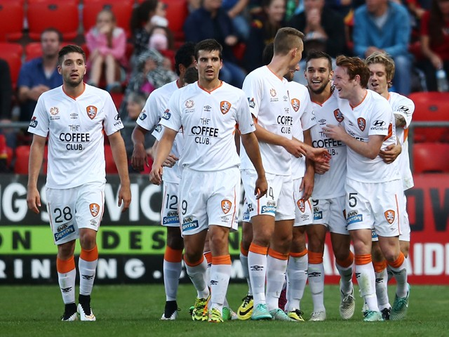 Brisbane players celebrates with teammate Andrija Kaluderovic after he scored a goal during the round 25 A-League match between Adelaide United and the Brisbane Roar at Coopers Stadium on April 11, 2015