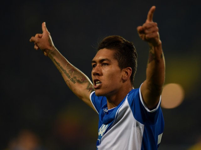 :Hoffenheim's Brazilian midfielder Roberto Firmino celebrates during the German Football Cup DFB Pokal quarter-final match between Borussia Dortmund and 1899 Hoffenheim in Dortmund, western Germany, on April 7, 2015