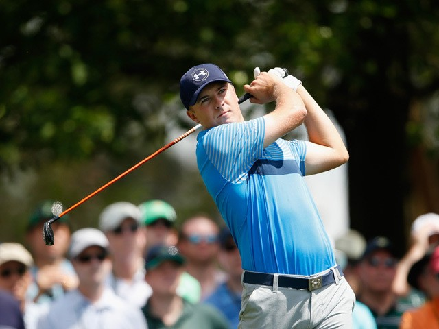 Jordan Spieth of the United States plays his tee shot on the fourth hole during the first round of the 2015 Masters Tournament at Augusta National Golf Club on April 9, 2015