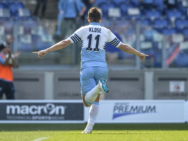 Lazio's forward from Germany Miroslav Klose celebrates after scoring during the Italian Serie A football match Lazio vs Empoli on April 12, 2015