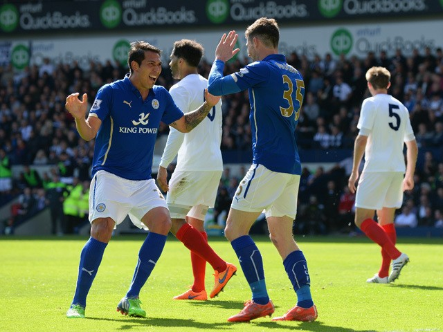 David Nugent of Leicester City celebrates scoring their first goal with Leonardo Ulloa of Leicester City during the Barclays Premier League match between West Bromwich Albion and Leicester City at The Hawthorns on April 11, 2015
