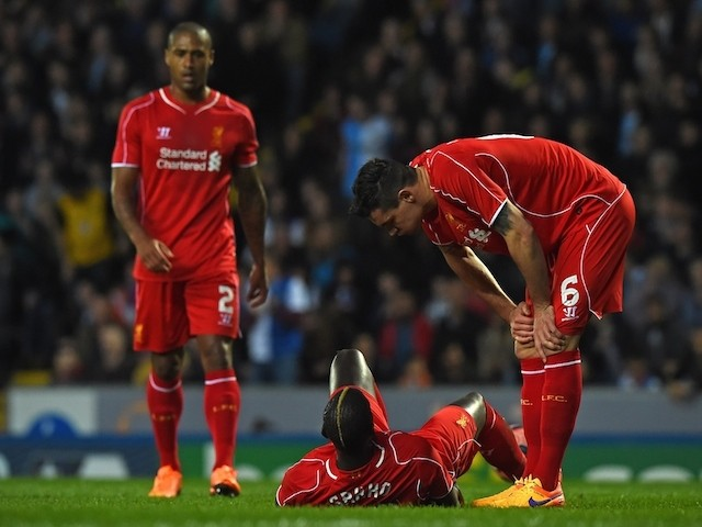 French defender Mamadou Sakho lays injured during the English FA Cup quarter-final replay football match against Blackburn Rovers on April 8, 2015