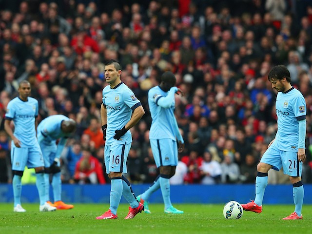 Dejection amongst the Manchester City ranks after a fourth goal by Manchester United on April 12, 2015
