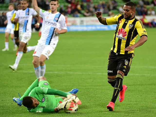 Tando Velaphi of Melbourne City dives on the ball during the round 25 A-League match between the Melbourne Victory and the Wellington Phoenix at AAMI Park on April 12, 2015