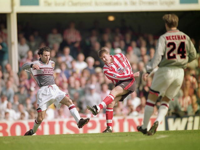 Matthew Le Tissier of Southampton shoots at goal as Ryan Giggs of Manchester United makes a challenge during the FA Carling Premiership match between Southampton and Manchester United held on April 13, 1996