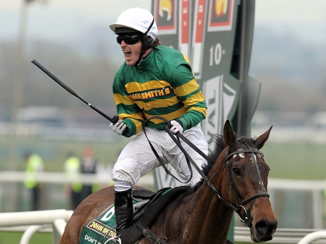 Jockey A P McCoy celebrates after winning on Don't Push It following The Grand National steeplechase at Aintree Racecourse in Liverpool, north-west England on April 10, 2010
