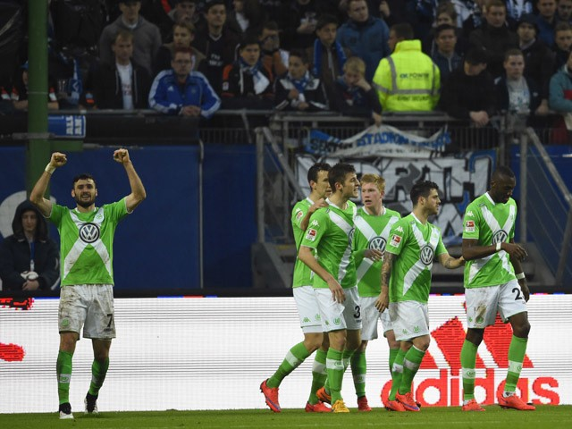 Wolfsburg's midfielder Daniel Caligiuri reacts after scoring during the German first division Bundesliga football match Hamburger SV vs VfL Wolfsburg in Hamburg, northern Germany, on April 11, 2015