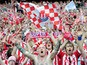 Stoke City fans celebrate their team winning at the final whistle during the FA Cup sponsored by E.ON semi final match between Bolton Wanderers and Stoke City at Wembley Stadium on April 17, 2011