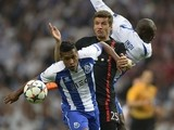 Porto's Brazilian defender Alex Sandro (L) vies with Bayern Munich's midfielder Thomas Muller during the UEFA Champions League quarter final football match FC Porto vs FC Bayern Munich at the at the Dragao stadium in Porto on April 15, 2015