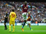 Christian Benteke of Aston Villa celebrates scoring their first goal during the FA Cup Semi Final between Aston Villa and Liverpool at Wembley Stadium on April 19, 2015