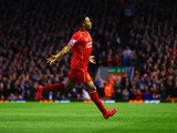 Raheem Sterling of Liverpool celebrates as he scores their first goal during the Barclays Premier League match between Liverpool and Newcastle United a