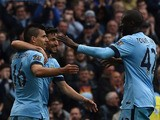 Manchester City's Argentinian striker Sergio Aguero celebrates scoring their second goal with Manchester City's Spanish midfielder Jesus Navas and Manchester
