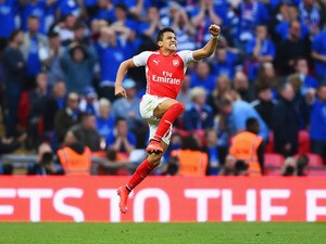 Alexis Sanchez of Arsenal celebrates as he scores their second goal during the FA Cup Semi Final between Arsenal and Reading at Wembley Stadium on April 18, 2015