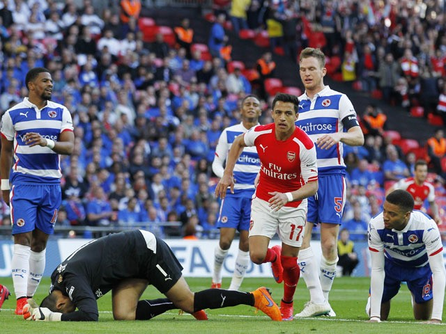 Arsenal's Chilean striker Alexis Sanchez runs past Reading's Australian goalkeeper Adam Federici after scoring during the FA Cup semi-final between Arsenal and Reading at Wembley stadium in London on April 18, 2015