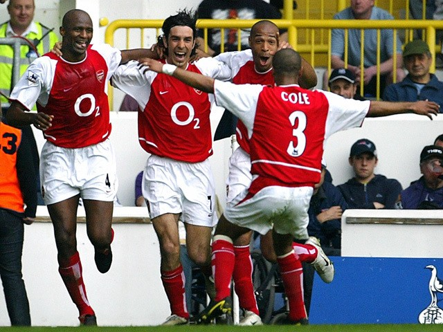 Arsenal's French midfielder Robert Pires celebrates his goal against Tottenham during their Premier League football clash at White Hart Lane in north London, 25 April 2004