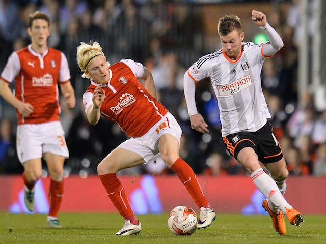 Ben Pringle of Rotherham United battles with Ryan Tunnicliffe of Fulham during the Sky Bet Championship match between Fulham and Rotherham United at Craven Cottage on April 15, 2015