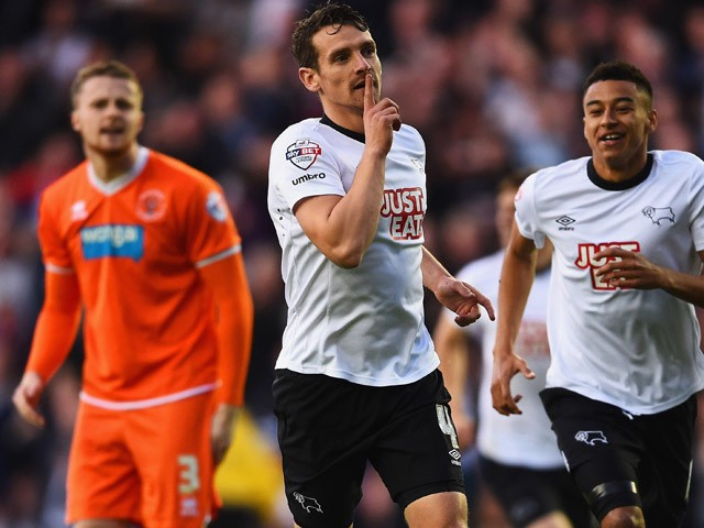 Niall Maher of Blackpool looks dejected as Craig Bryson of Derby County celebrates with Jesse Lingard as he scores their first goal during the Sky Bet Championship match between Derby County and Blackpool at iPro Stadium on April 14, 2015