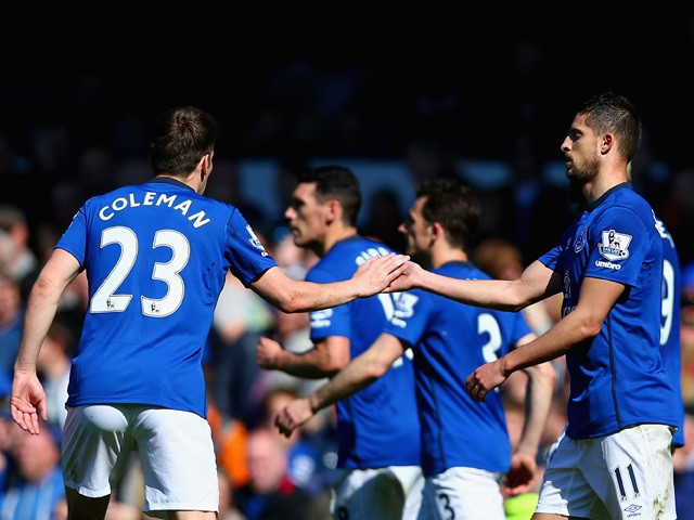 Seamus Coleman of Everton congratulates Kevin Mirallas of Everton on scoring the opening goal during the Barclays Premier League match between Everton and Burnley at Goodison Park on April 18, 2015
