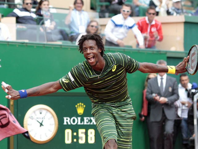 French player Gael Monfils celebrates after winning his Monte-Carlo ATP Masters Series Tournament tennis match against Bulgaria's Grigor Dimitrov on April 17, 2015