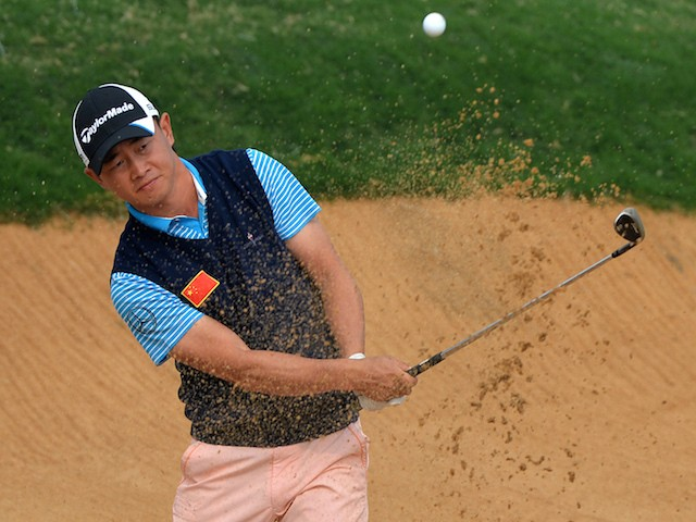 Huang Wen Yi of China plays from the bunker on the 7th hole during day one of the BMW Shanghai Masters golf tournament at the Lake Malaren Golf Club in Shanghai on October 24, 2013