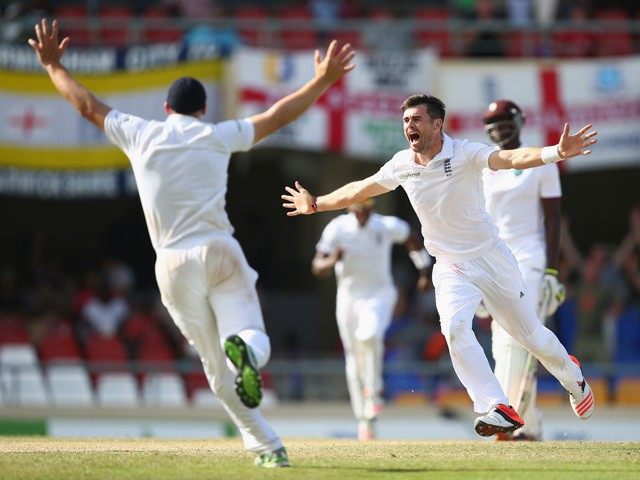 James Anderson of England claims the wicket of Denesh Ramdin of West Indies to pass Ian Botham's record of 383 Test wickets and become England's highest Test wicket bowler during day five of the 1st Test match between West Indies and England at the Sir Vi