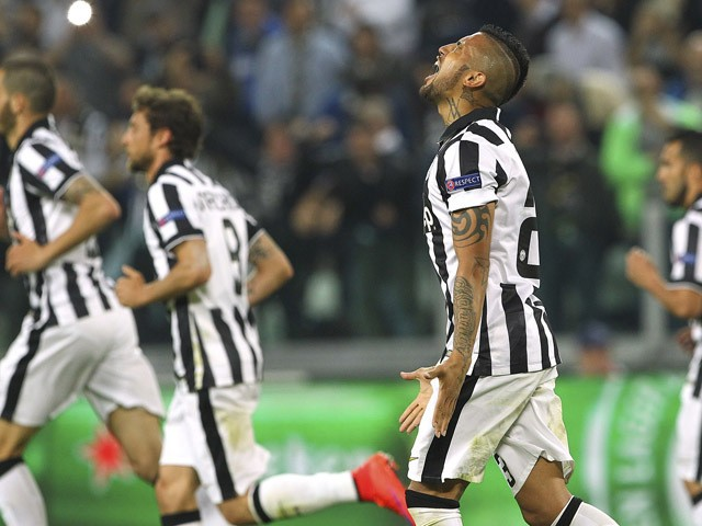 Arturo Vidal of Juventus FC celebrates after scoring the opening goal during the UEFA Champions League Quarter Final First Leg match between Juventus and AS Monaco FC at Juventus Arena on April 14, 2015