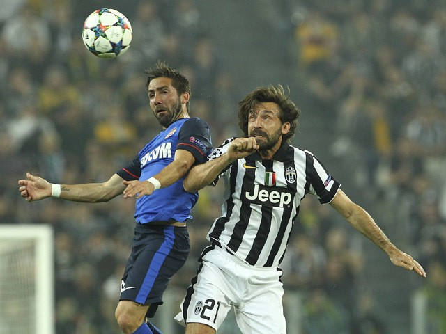 Joao Moutinho of AS Monaco FC competes for the ball with Andrea Pirlo of Juventus FC during the UEFA Champions League Quarter Final First Leg match between Juventus and AS Monaco FC at Juventus Arena on April 14, 2015