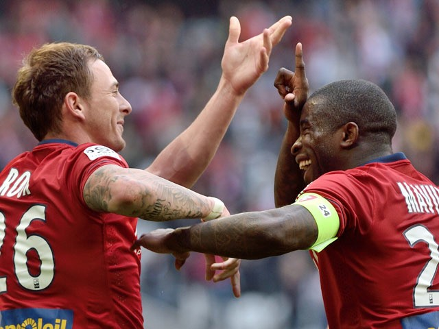 Lille's French forward Nolan Roux celebrates after scoring a goal during the French L1 football match between Lille and Bordeaux at the Pierre Mauroy Stadium in Villeneuve d'Ascq northern france on April 19, 2015
