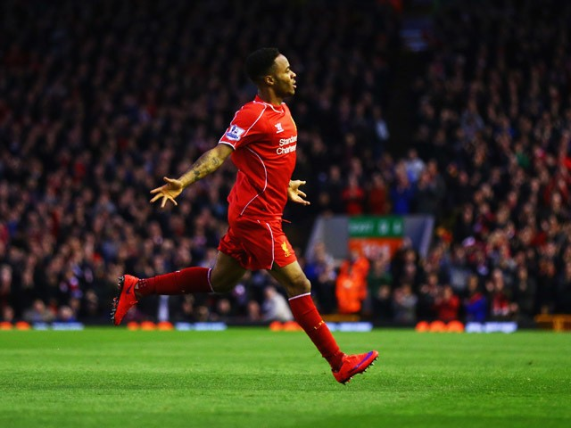 Raheem Sterling of Liverpool celebrates as he scores their first goal during the Barclays Premier League match between Liverpool and Newcastle United at Anfield on April 13, 2015