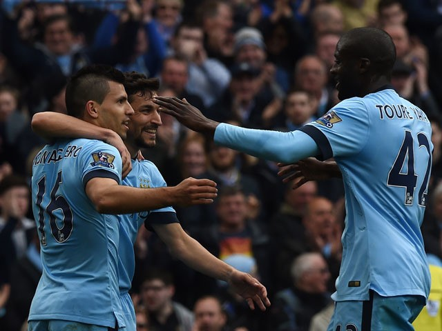 Manchester City's Argentinian striker Sergio Aguero celebrates scoring their second goal with Manchester City's Spanish midfielder Jesus Navas and Manchester City's Ivorian midfielder Yaya Toure during the English Premier League football match between Man