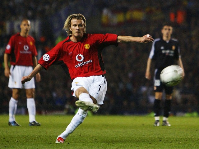 David Beckham of Man Utd scores the third goal from a free kick during the UEFA Champions League quarter final, second leg match between Manchester United and Real Madrid on April 23, 2003