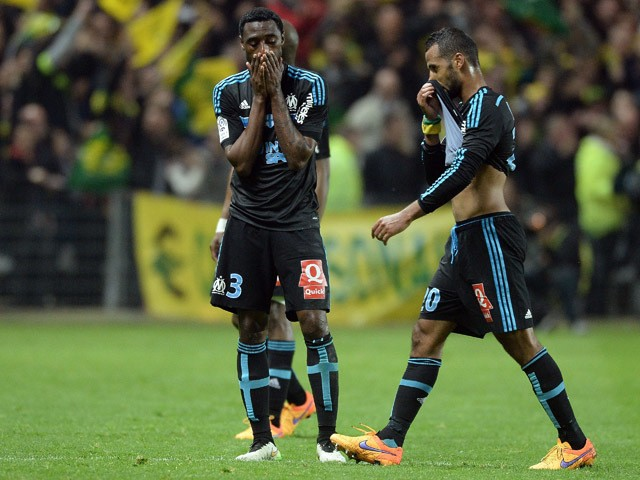 Marseille's players react at the end of the French L1 football match between Nantes and Marseille on April 17, 2015