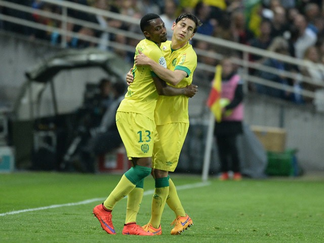 Nantes' Togolese forward Serge Gakpe celebrates with Nantes' US midfielder Alejandro Bedoya after scoring a goal during the French L1 football match between Nantes and Marseille on April 17, 2015