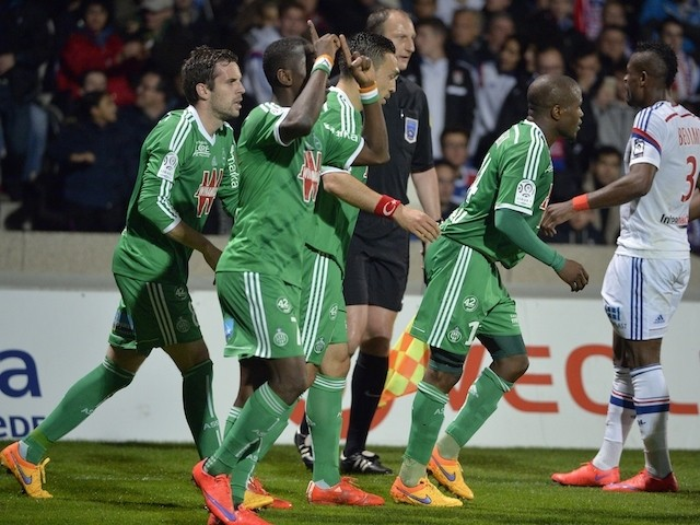 Saint-Etienne's players celebrates after scoring a goal during the French L1 football match between Lyon and Saint-Etienne on April 19, 2015
