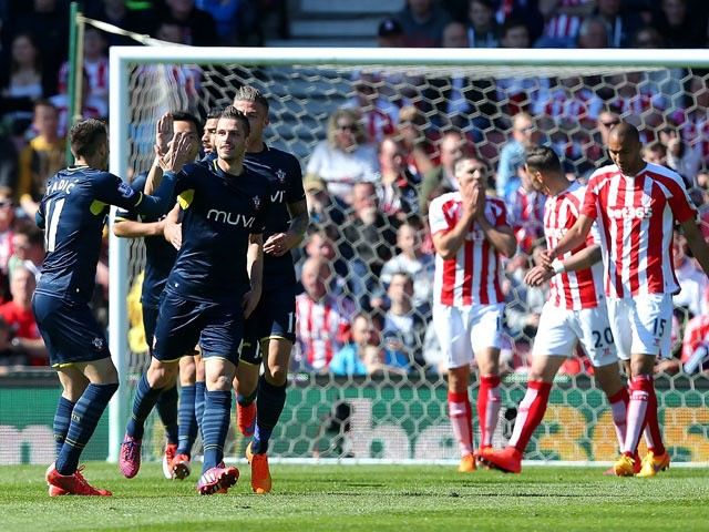 Morgan Schneiderlin of Southampton celebrates the first goal with his team-mates during the Barclays Premier League match between Stoke City and Southampton at the Britannia Stadium on April 18, 2015