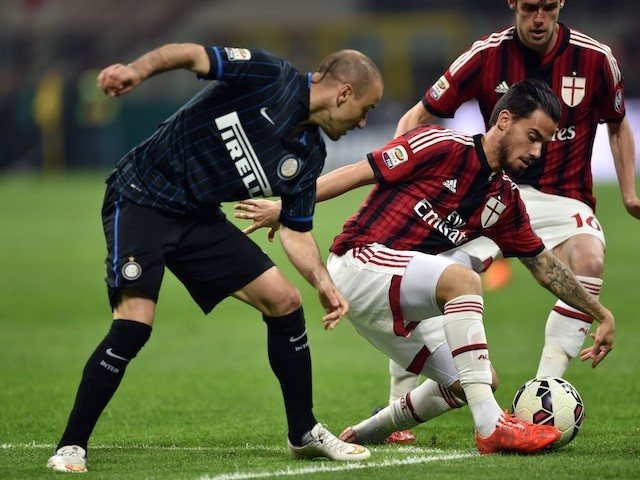 AC Milan's midfielder from Spain Suso (R) fights for the ball with Inter Milan's forward from Argentina Rodrigo Palacio (L) during the Italian Serie A football match Inter Milan vs AC Milan at the San Siro Stadium in Milan on April 19, 2015