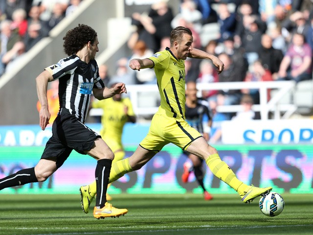 Harry Kane of Spurs is chased down by Fabricio Coloccini of Newcastle United during the Barclays Premier League match between Newcastle United and Tottenham Hotspur at St James' Park on April 19, 2015
