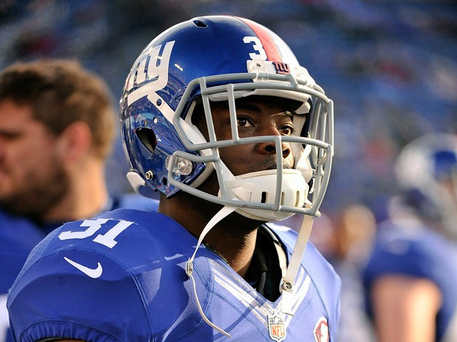 Zack Bowman #31 of the New York Giants watches from the sideline during the second half of a game against the Tennessee Titans at LP Field on December 7, 2014