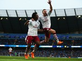 Tom Cleverley of Aston Villa celebrates with goalscorer Carlos Sanchez during the Barclays Premier League match between Manchester City and Aston Villa at Etihad Stadium on April 25, 2015
