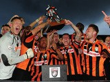 The Barnet Team celebrate with the trophy after clinching promotion during the Vanarama Football Conference League match between Barnet and Gateshead at The Hive on April 25, 2015